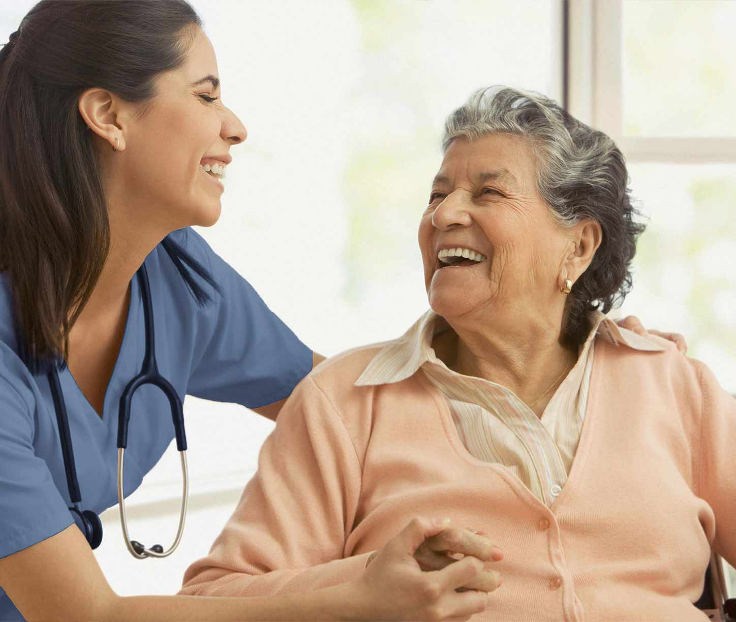 nurse and patient sharing a laugh