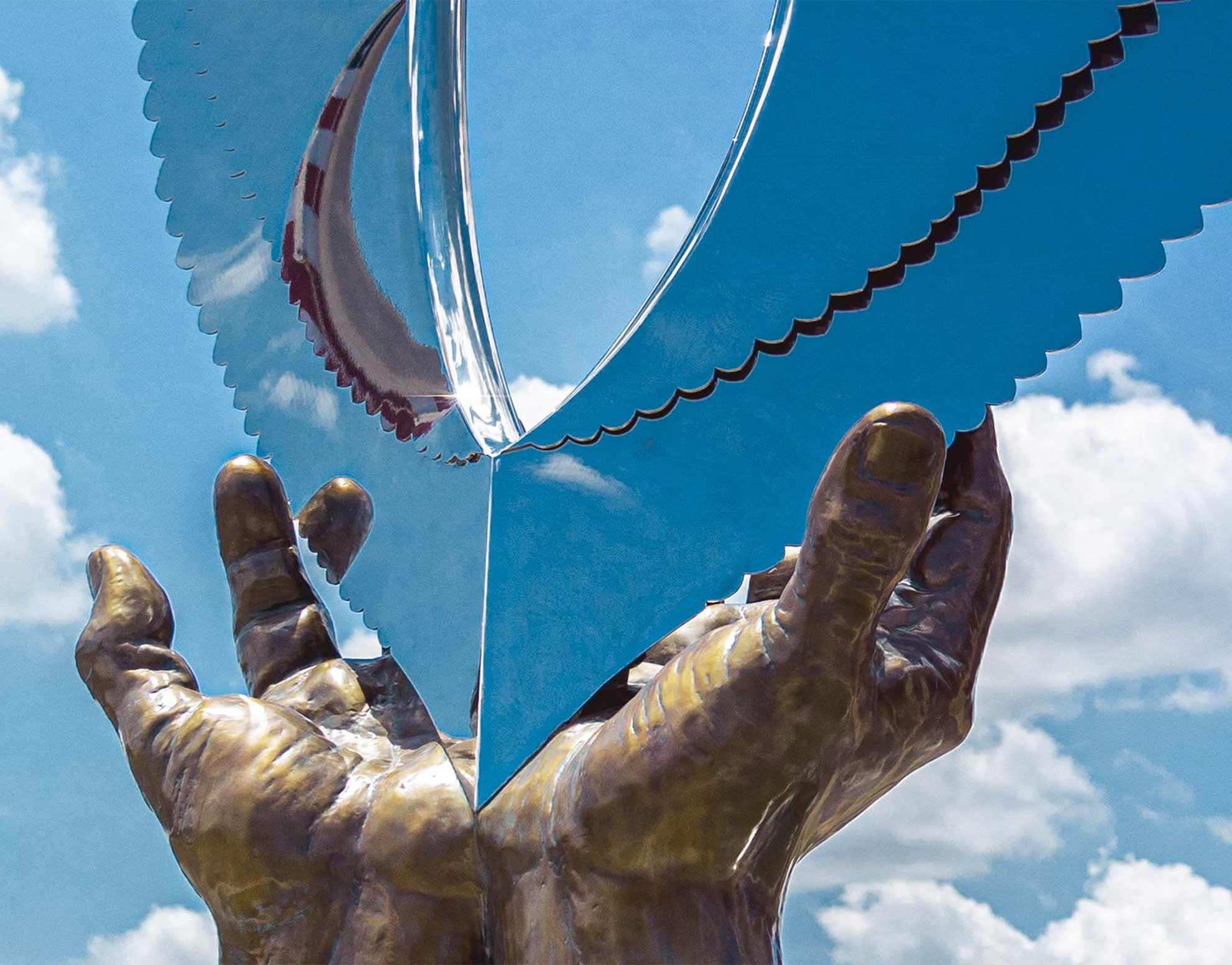 wings of hope, hands of healing sculpture
