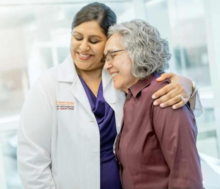 UT Health San Antonio MD Anderson Cancer Center doctor hugs a patient